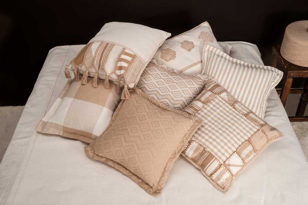 Pillows and bed cover made in organic colored cotton.